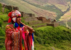 Quetchua_musician_with_Inca_ruins_of_Pisac_in_background_Andes_Mts_Peru_copy